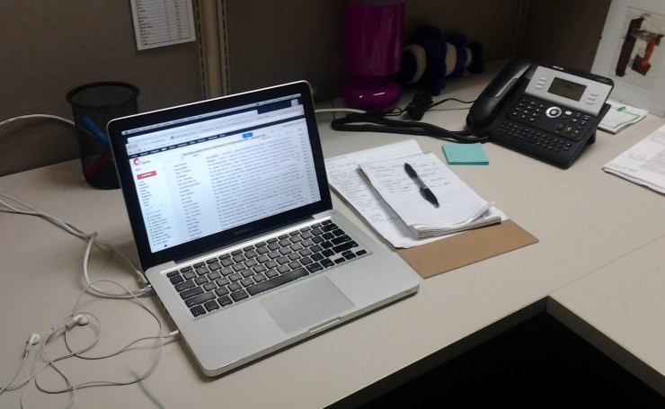 This is what my cubicle looks like at the beginning of a day of writing copy at the office.