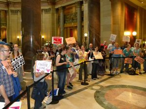 Pro-gay-marriage protesters inside the state capitol building in St. Paul, Minnesota in 2012. Image courtesy of Wikimedia Commons..