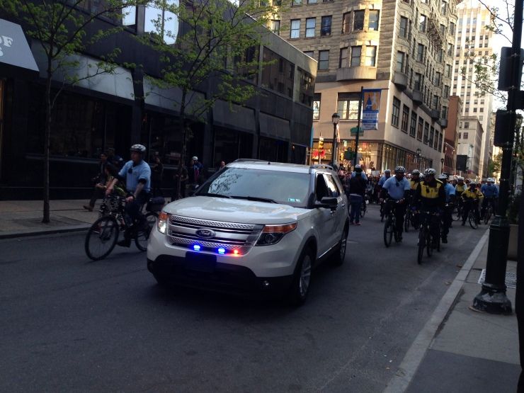 Police escort the protesters up 16th Street, just north of Walnut.